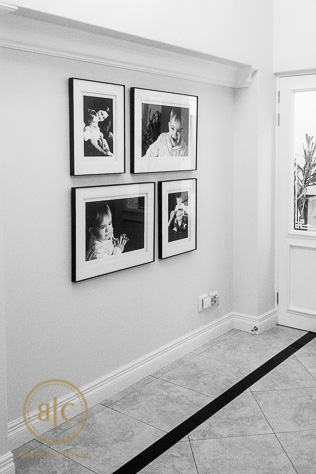 Framed Family Photo Gallery in Home Entrance